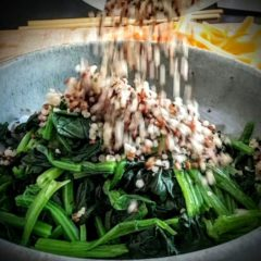 Add quinoa to blanched spinach salad